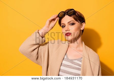 Stylish Look Of The Model In Fashionable Sunglasses And Casual Clothes On The Bright Yellow Backgrou