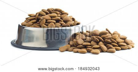 Dry kibble dog food in metal bowl isolated on white background.