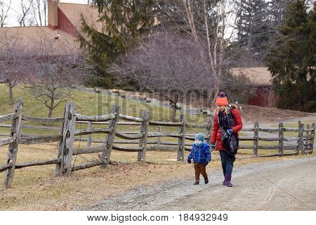 Mother and son walking together outside in wintertime
