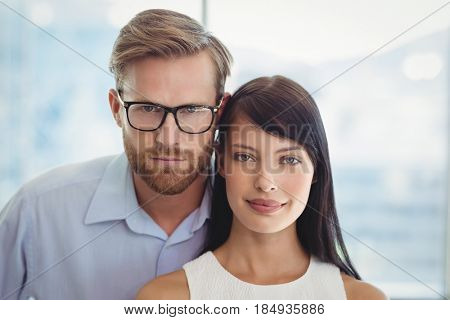 Portrait of smiling couple in office