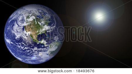 Planet earth with sun shining.