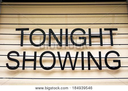 Traditional movie theatre sign advertising latest performance
