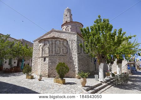 ancient square of areopolis in greece on mani peninsula of peloponnese with old church in spring
