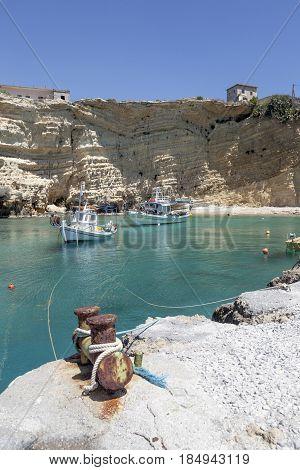 harbor of mezakos with fishing boats on mani in greek peloponnese