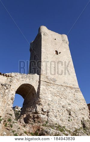 typical ancient Mani tower and blue sky in Greek town of kardamili on peloponnese