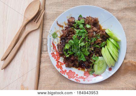 Thai homemade food stir fried pork with sugar it called