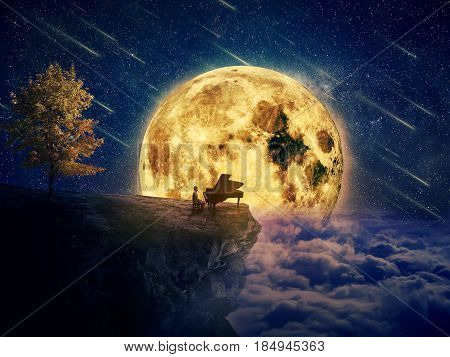 Night scene with a boy musician standing at the edge of a cliff chasm with his piano. Waiting for music inspiration in the center of nature over a full moon night background.