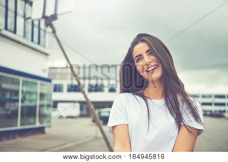 Woman Making Faces For Camera On Stick