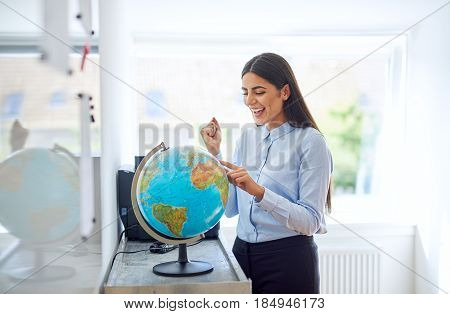 Happy Exuberant Young Woman Planning A Trip
