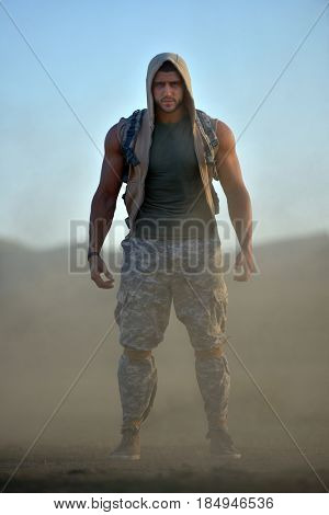 athletic young man on dusty field