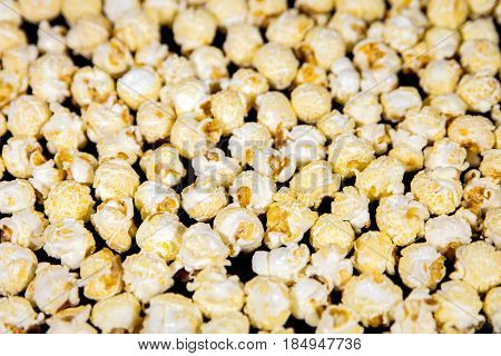 Popcorn background sweet caramel popped corns concept party and cinema