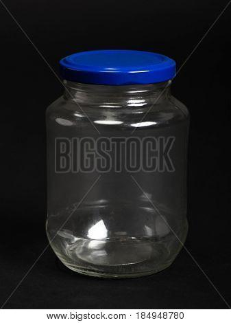 Empty glass jar on the back background