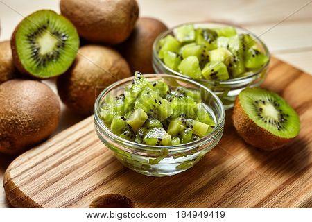 Healthy Food. Tropical Fruit. Whole And Sliced Kiwi. Kiwi Fruit. Still Life. Juicy Kiwi On The Woode