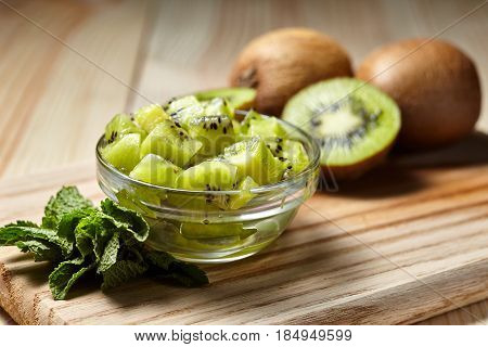 Healthy Food. Tropical Fruit. Whole And Sliced Kiwi. Kiwi Fruit. Still Life. Juicy Kiwi On The Woode