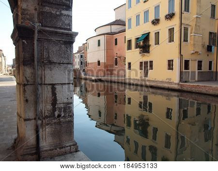 Chioggia, Italy.  Ancient palaces reflected in the canal water