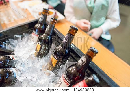 OREGON CITY, OR - APRIL 9, 2017: Deschutes Brewery beer on ice in the getting ready room of the groom at Abernethy Center.