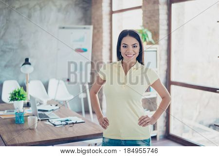 Portrait Of Beautiful Smiling Successful Young Hispanic Businesswoman Standing At Her Office