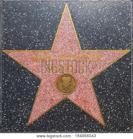 LOS ANGELES USA - JUNE 24 2012: Mark Serrurier Moviola's star on Hollywood Walk of Fame in Hollywood California. This star is located on Hollywood Blvd. and is one of 2400 celebrity stars.