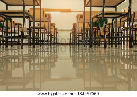 School classroom with desks chair wood and greenboard in high school thailand vintage tone education concept