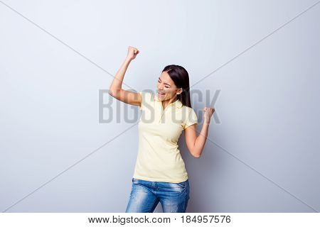 Yes! Victory! Portrait Of Successful Smiling Young Girl In Casual Clothes Celebrating Victory