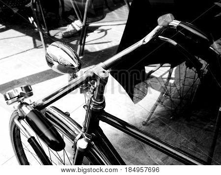 Bicycle Details. Handlebar and lantern. Black and white photo.