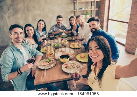 Hispanic Cute Girl Is Making Selfie With Her Friends At The Birthday  Party On Her Phone`s Camera. E
