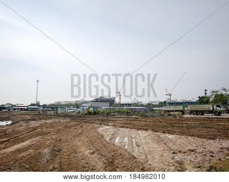 Real estate developer construction area and construction cranes.