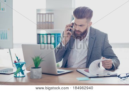 Confident Handsome Young Man Is Having A Business Conversation, Checking Information On Papers And C