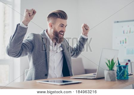 Great Job! Very Excited Businessman Is Celebrating The Growth Of Conmpany`s Income. Hia Hands Are Ra