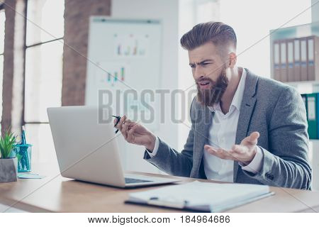 Young Shocked Businesswoman Took Off His Glasses And Looking At Laptop, He Can`t Believe The News He