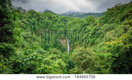 Wide angle view of La Fortuna de San Carlos waterfall in Arenal volcano national park, Costa Rica