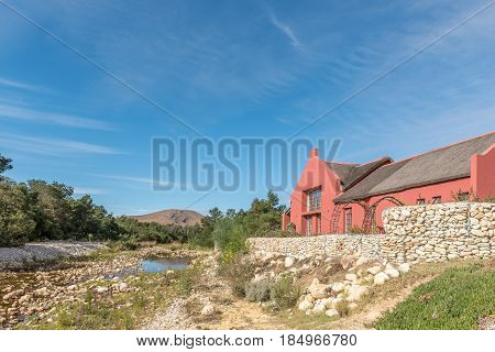 GREYTON SOUTH AFRICA - MARCH 27 2017: A view of Gobos riverbed and a house in Greyton a small town in the Western Cape Province of South Africa