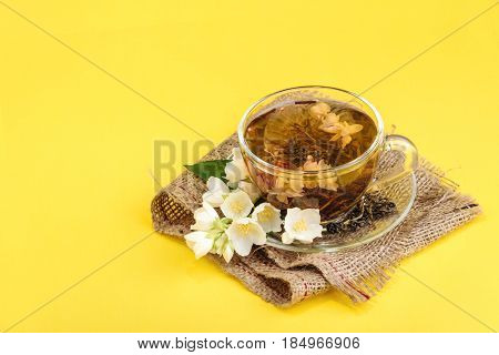 Cup Of Jasmine Tea With Flowers