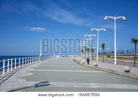 Photo of several streetlights with blue sky and sunlight