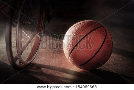 Basketball and Wheel chair in a lonely atmosphere in concept Disappointment injury discouragement despair