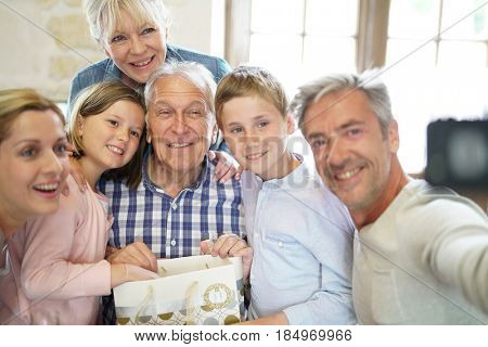 Family celebrating grandfather birthday together