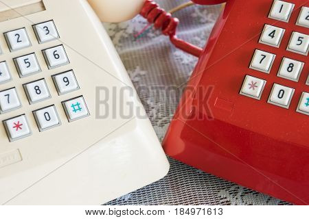 Duo old telephone in red and white color