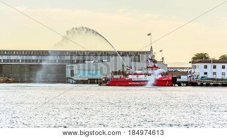 San Francisco CA USA october 2016: San Francisco Fireboat 3 docked near the Embarcadero spraying bright streams of water
