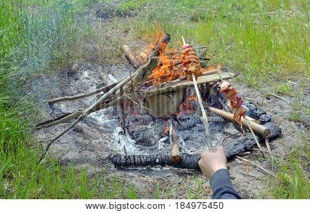 Teen boy enjoying barbecue outdoors, close up
