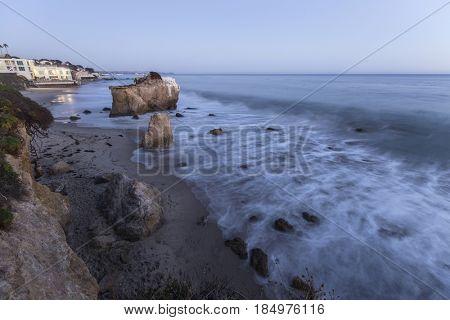 Dusk view of El Matador State Beach surf in Malibu California.