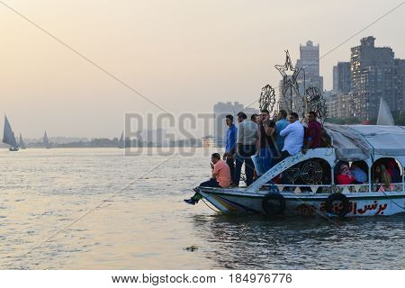 Cairo, EGYPT - MAY 21, 2016: The passenger ferry sails at sunset in Cairo, EGYPT