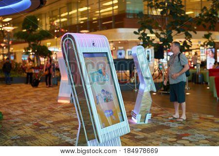 SINGAPORE - CIRCA SEPTEMBER, 2016: kiosks around Social Tree at Singapore Changi Airport. The Social Tree allows visitors to post their photos and videos.