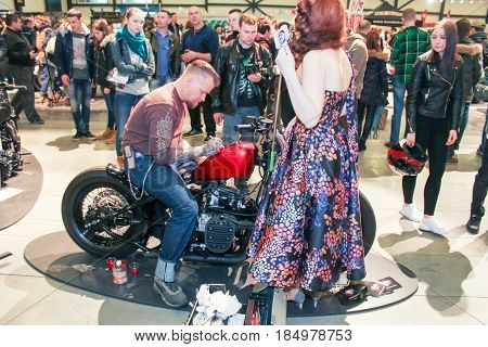 St. Petersburg Russia - 15 April, Motor artist at work,15 April, 2017. International Motor Show IMIS-2017 in Expoforurum. Visitors and participants of the annual moto-salon in St. Petersburg.