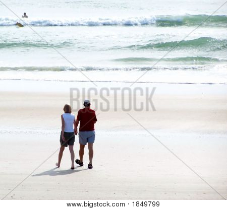 Couple Walking On Beach