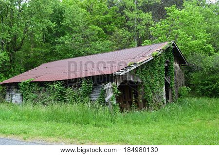 Old moss covered, metal roofed barn in the country