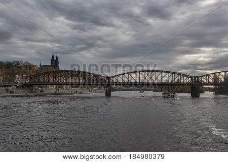 PRAGUE CZECH REPUBLIC - NOVEMBER 4 2012: Visegrad railway bridge is the third largest and oldest in Prague. It connects the Main Prague Railway Station and Smichowski.