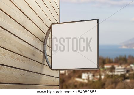 Close up of empty square stopper on wooden building. City background. Pub/bar/cafe/shop concept. Mock up 3D Rendering