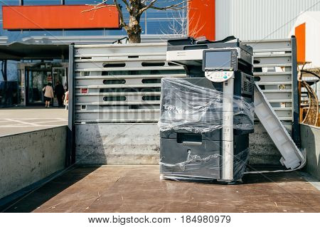 Technology transportation - Modern multifunction copy machine in van trunk during office moving - office equipment transportation