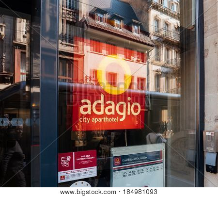 STRASBOURG FRANCE - APR 27 2017: Adagio hotel facade with city reflection in the glass window. Adagio City Aparthotel is a joint venture launched by Accor Hotels and Pierre & Vacances and is a major hotel company offering rooms with cooking facilities