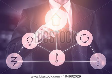 Futuristic interface of smart home automation assistant on a virtual screen and a businessman touching a button. 3D Rendering